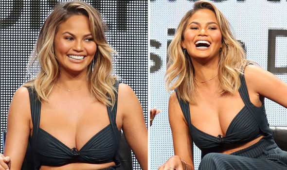 Chrissy Teigen played RummiKub as others were tossing champagne flutes to the ball to welcome 2021.